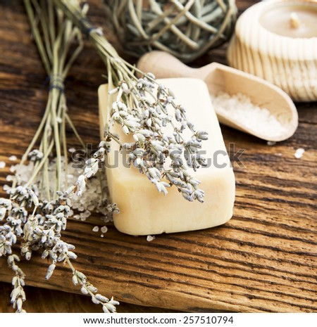 Natural Lavander Soap with Lavender Flowers on Wooden Background.Spa Bodycare Products - stock photo