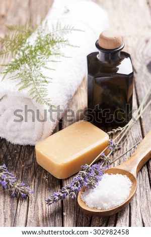 Natural lavander soap with lavender flowers on wooden table