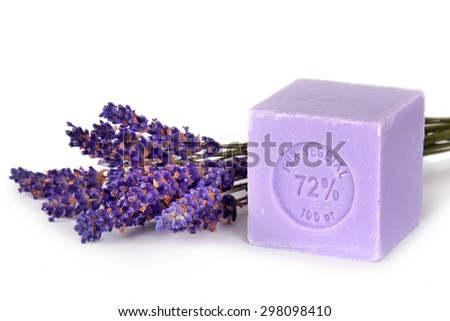 Natural lavender soap with lavender flowers on it - stock photo