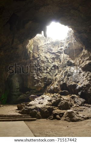 Natural light inside the cave. - stock photo