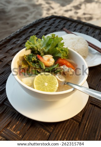 Natural light photo of lemongrass seafood soup with steamed rice, shallow DOF view 4 - stock photo