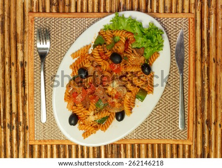 Natural light photo of macaroni pasta with bolognese sauce and parmesan cheese on a white plate top view 3 - stock photo