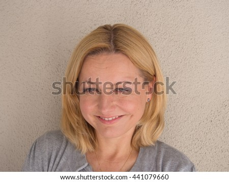 Natural light portrait of attractive European woman.