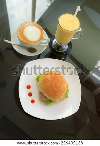Natural lighting photo of casual breakfast in cafe with shallow DOF  - stock photo