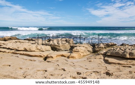 Natural limestone and turquoise Indian Ocean seascape under a blue sky at Penguin Island in Rockingham, Western Australia/Limestone Coast and Sea/Penguin Island, Rockingham, Western Australia - stock photo