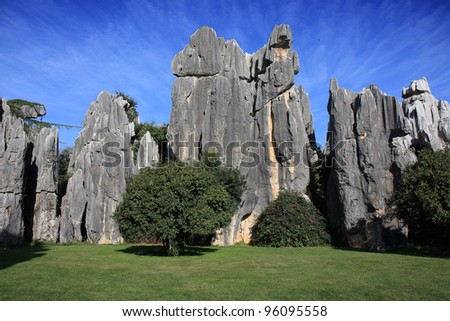 Natural limestone formation at the Shilin Stone Forest National Park, near Kunming, China. - stock photo