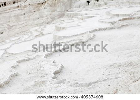 Natural limestone terraces at ancient Hierapolis, or Pamukkale, Turkey - stock photo