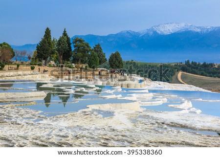 Natural limestone water pools in Pamukkale  - stock photo