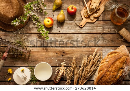 Natural local food products on vintage wooden table - rustic composition captured from above. Country lifestyle, rural vacation or agritourism concept. Background layout with free text space. - stock photo