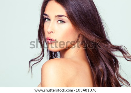 natural looking green eye young woman beauty portrait, studio shot, brunette, long hair - stock photo