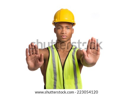 Natural Looking Worried Young African American Construction Worker Gesture NO on Isolated Background - stock photo
