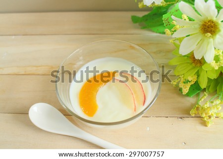 Natural low-fat yogurt mix peach and apple slice