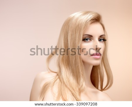 Natural makeup, fashion. Attractive blonde girl face. Sexy model girl on pink, shiny straight hair, nude makeup, long eyelashes, perfect skin. Beauty woman, skincare spa concept, model face closeup - stock photo