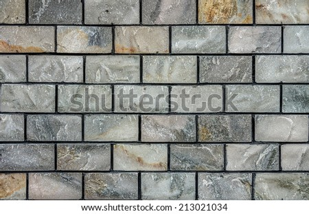 Natural marble stone brick wall for background and texture - stock photo