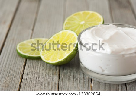 natural moisturizer cream with fresh lime on wooden - stock photo