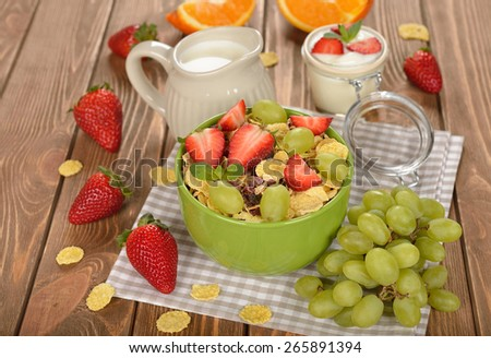 Natural muesli with fruit on a brown background - stock photo