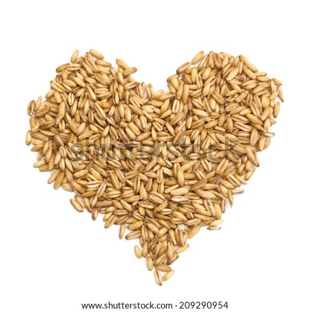 natural oat grains in form of the heart, isolated on white background
