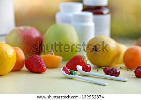 Natural or synthetic vitamins ? (healthy eating) - stock photo