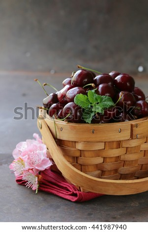 Natural organic berries cherries in a basket - stock photo