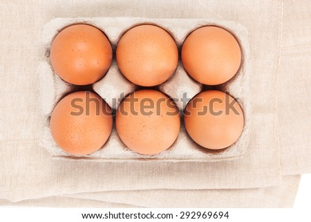 Natural organic chicken eggs in cardboard package, top view. - stock photo