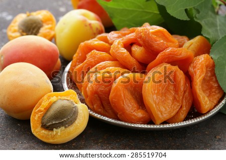 Natural organic dried apricots, rustic still life - stock photo