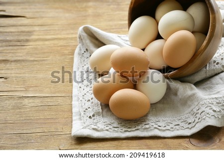 natural organic eggs in a wooden bowl - stock photo