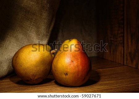 Natural organic farm grown pears in traditional vintage style composition artistic photograph style classic still life - stock photo