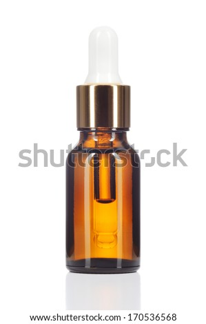 Natural organic oil isolated on white background. Body oil in brown bottle.