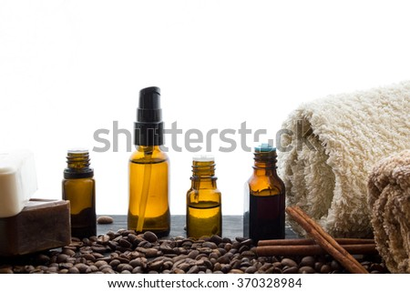 natural organic soap bottles essential oil and sea salt herbal bath  on a wooden table coffee background - stock photo