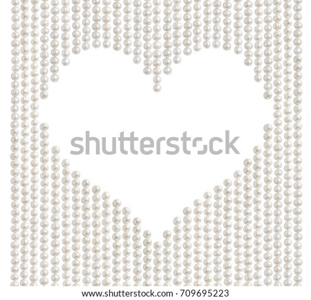 Natural pale pearl beads (necklace) with heart shaped copy space in the middle, isolated on white