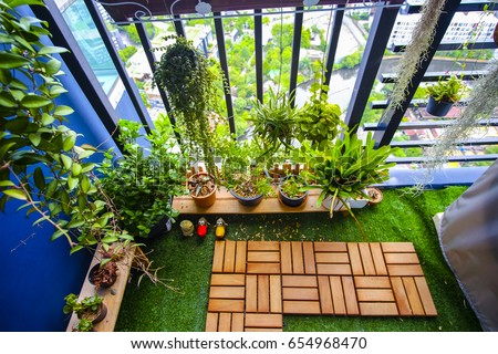 balcony garden. Natural Plants In The Hanging Pots At Balcony Garden A