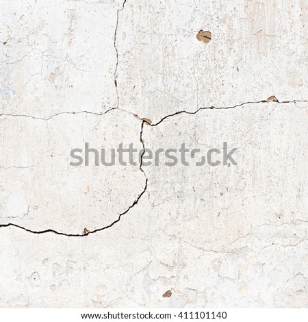 Natural plaster wall surface for texture or backgrounds. White house wall with cracks.