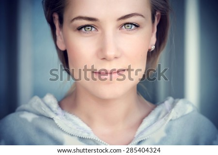 Natural portrait of a beautiful woman, authentic beauty of Caucasian female face, lite makeup on perfect skin and green eyes, genuine natural looking girl - stock photo