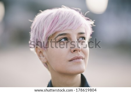natural portrait of young woman with pink hair - stock photo