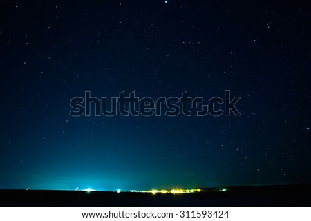 Natural Real Night Sky Stars Background Texture. Starry Sky Over City - stock photo
