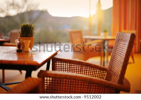 Natural restaurant interior with scenic view at sunset - stock photo