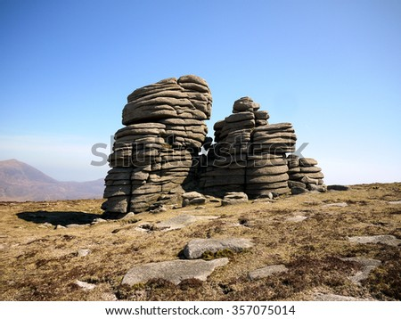 Natural rock formation on mountain plain. - stock photo