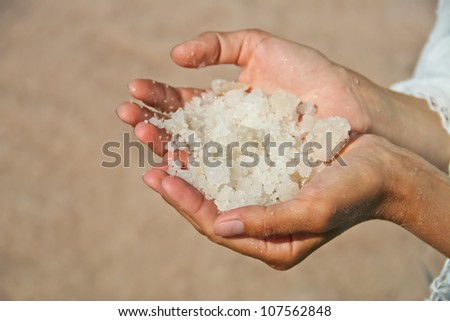 Natural salt in the hands of a girl