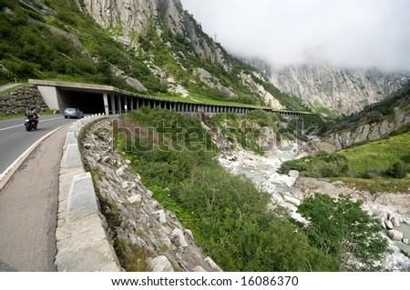 natural scene with tunnel seen on the way through Swiss Alps