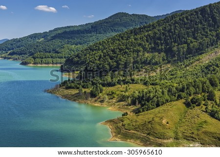 Natural scenery with clear water lake, Buzau river valley, Romania. - stock photo