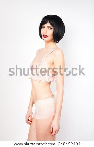 natural sexy attractive woman in white lingerie posing relaxed and smiling on white background - stock photo