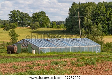 Natural small greenhouse on the field. - stock photo