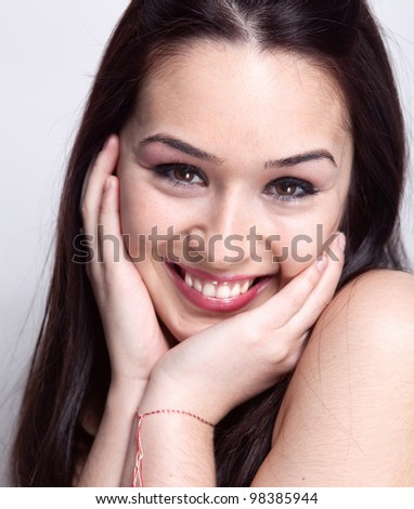 Natural smile of cute pretty young woman