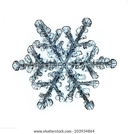 natural snowflake isolated on a white background a strong increase - stock photo