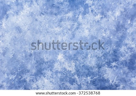 Natural snowflakes close-up on background of snow on sunny day - stock photo