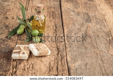 natural soap bars made by olive and oil on wooden table
