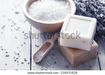 Natural soap, lavender, salt on a wooden board. - stock photo