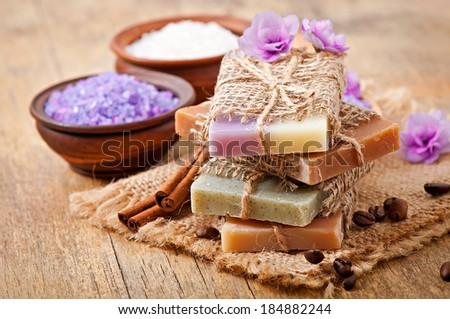 Natural soap on wooden background - stock photo