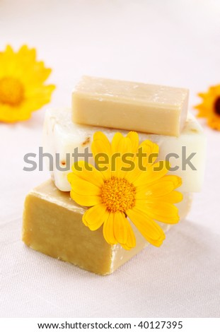 Natural soap with marigold flowers close up