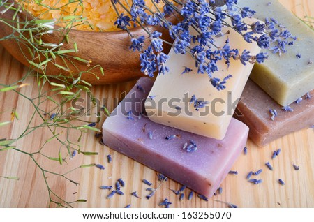 Natural soaps with bath salt and lavender flowers on wooden background - stock photo